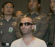 Le canadien après son arrestation par la police Thai